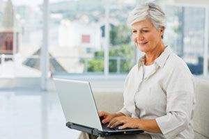 Middle aged woman shopping from Canadian pharmacy website