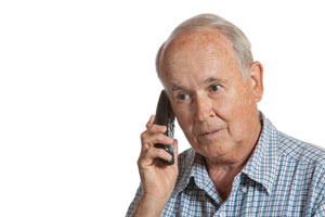 Elderly man speaking to a canadian pharmacy over the phone